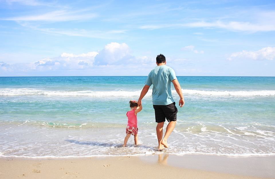 father and daughter enjoy a siesta key beach